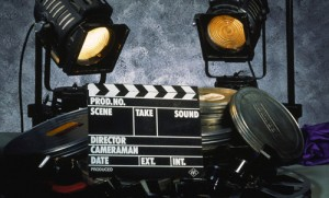 Clapperboard, film and two floodlights