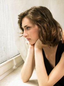 Brunette Young Woman Looking out of Window