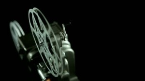 stock-footage-film-reel-of-an-mm-vintage-projector-and-black-background